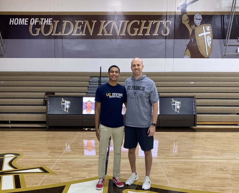 St. Francis guard Andre Henry, at left with coach Todd Wolfson, will play basketball for UC Irvine.