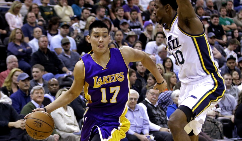 Lakers guard Jeremy Lin drives around Jazz forward Jeremy Evans in the second quarter of a game Wednesday in Utah.