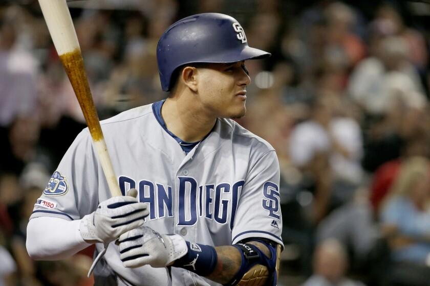Padres third baseman Manny Machado bats against the Arizona Diamondbacks on Friday.