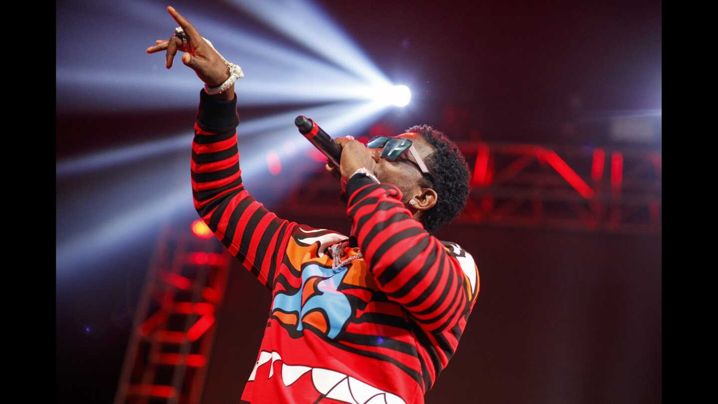 """Gucci Mane performs on the main, """"Loud Stage,"""" at the Rolling Loud music festival."""