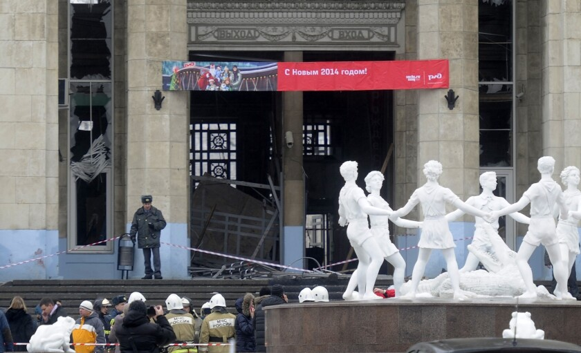 A police officer guards a main entrance to the Volgograd railway station hit by an explosion Sunday.