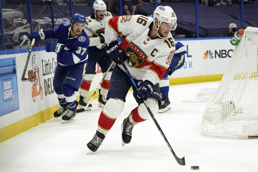 Florida Panthers center Aleksander Barkov (16) breaks out after taking the puck from Tampa Bay Lightning center Yanni Gourde (37) during the second period in Game 6 of an NHL hockey Stanley Cup first-round playoff series Wednesday, May 26, 2021, in Tampa, Fla. (AP Photo/Chris O'Meara)