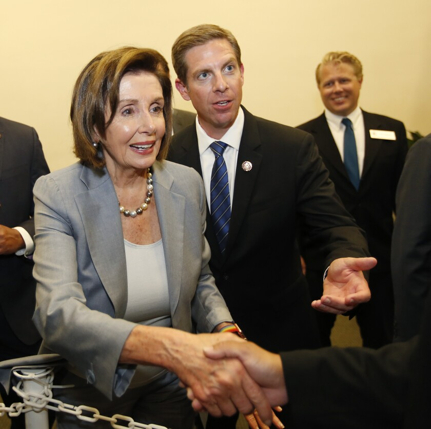 Speaker Nancy Pelosi with Rep. Mike Levin, right