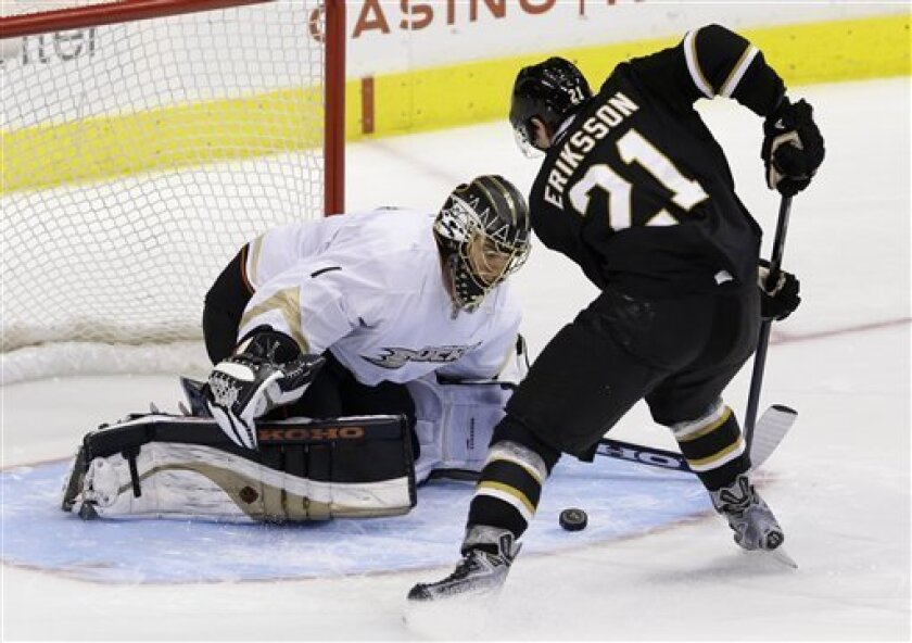 Anaheim Ducks goalie Jonas Hiller (1), of the Czech Republic, prepares to smother a shot-attempt by Dallas Stars' Loui Eriksson (21), of Sweden, during a shootout in an NHL hockey game on Thursday, March 14, 2013, in Dallas. The Ducks won 2-1. (AP Photo/Tony Gutierrez)