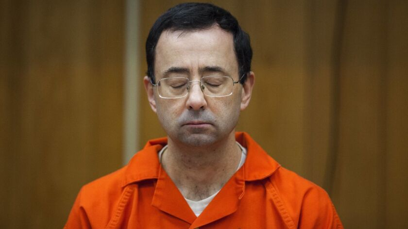 FILE - In this Feb. 5, 2018, file photo, Larry Nassar listens during his sentencing at Eaton County
