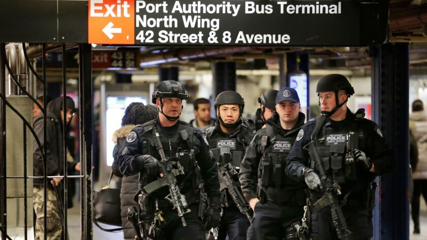 Police officers patrol in the passageway connecting New York City's Port Authority bus terminal and