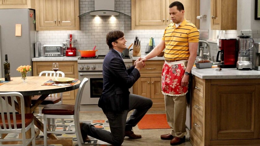 """Ashton Kutcher, left, and Jon Cryer in """"Two and a Half Men"""" on CBS."""