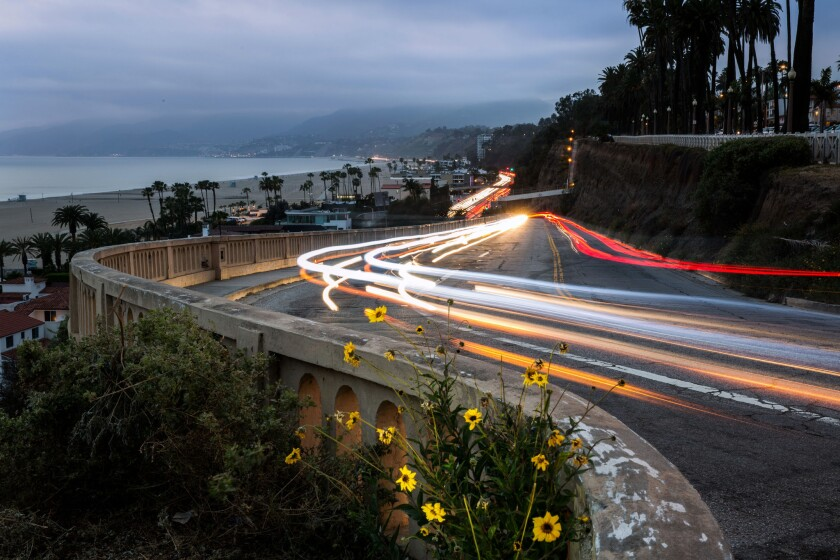 In March, the light trails of vehicles are shown moving up and down the California Incline in Santa Monica. Reconstruction of the deteriorating roadway is to start Monday.