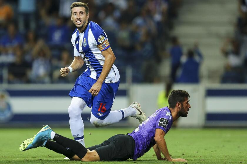FC Porto's Hector Herrera (L) celebrates after scoring the opening goal during the Portuguese First League soccer match between FC Porto and Moreirense FC in Porto, Portugal, 02 September 2018.