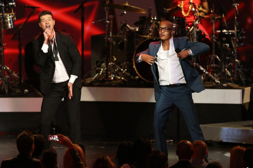 """FILE- In this Dec. 6, 2013, file photo, Robin Thicke, left, and T.I. perform """"Blurred Lines"""" at the Grammy Nominations Concert Live! at the Nokia Theatre L.A. Live in Los Angeles. More than 200 musicians filed a brief with the Ninth Circuit Court of Appeals on Tuesday, Aug. 30, 2016, to express con"""