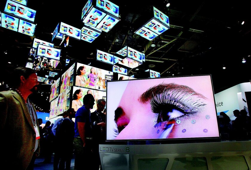 A wall of 4K television monitors illuminate the way at CES in Las Vegas in this file photo.