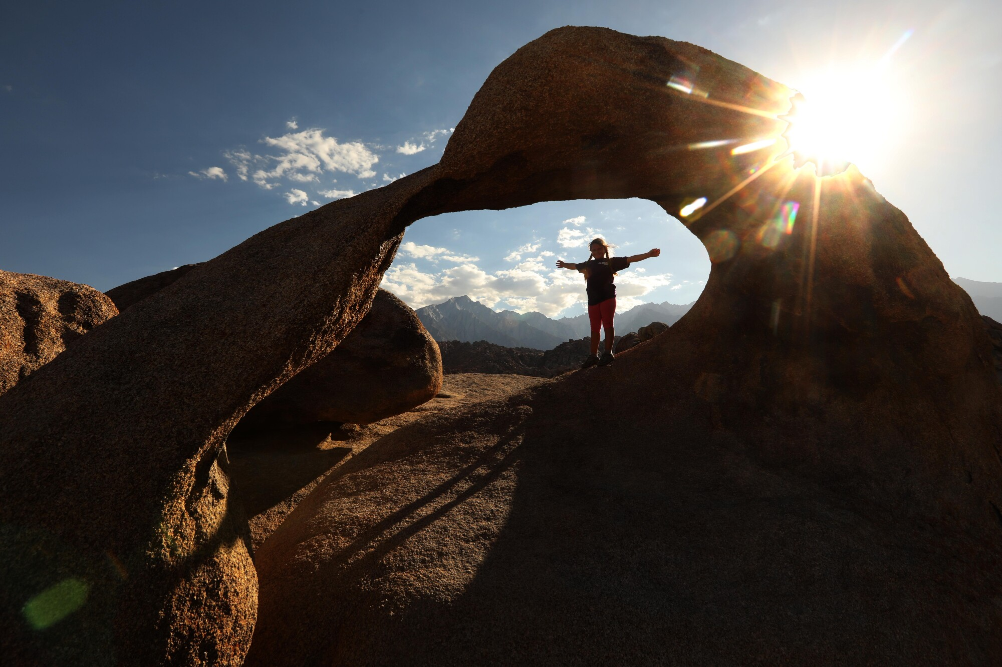 Charlie Heller, 7, of Simi Valley is framed by the Mobius Arch which is part of Alabama Hills National Scenic Area.