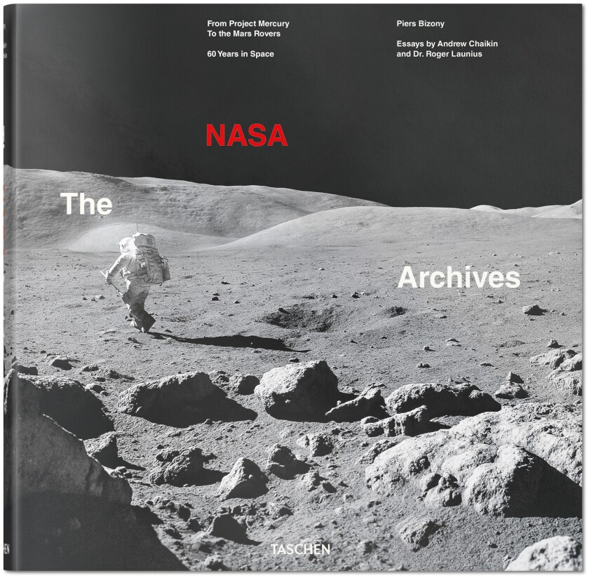 """A book jacket for """"The NASA Archives: 60 Years in Space"""" by Chaikin Andrew and Dr. Roger Launius. C"""