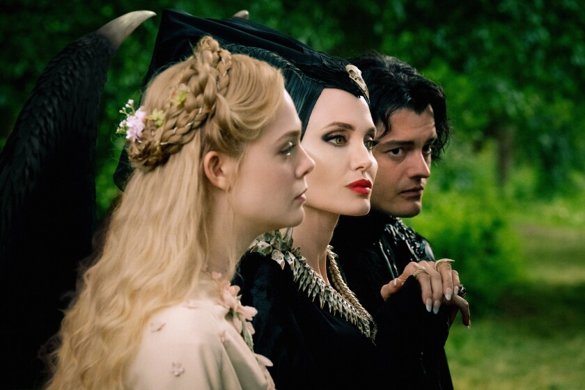 "Elle Fanning, Angelina Joley and Sam Riley in the movie ""Maleficent: Mistress of Evil."""