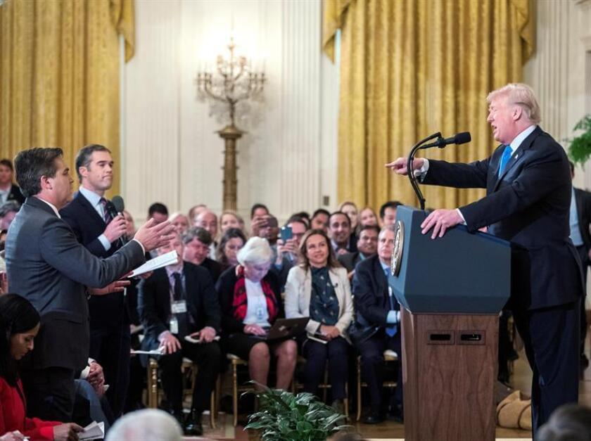President Donald Trump (r) responds to CNN reporter Jim Acosta (standing, l) at a White House press conference. After a press conference confrontation between the two men on Nov. 7, 2018, the administration suspended Acosta's press credentials, spurring CNN to sue Trump and five staffers for violating freedom of the press. EFE-EPA/File