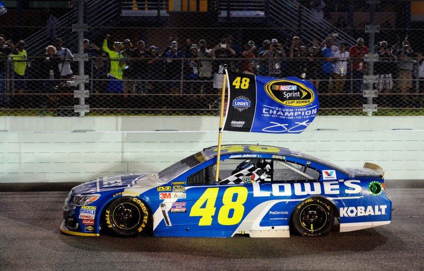 Jimmie Johnson, driving his No. 48 Lowe's Chevrolet, celebrates at Homestead-Miami Speedway after winning the NASCAR Sprint Cup Series Ford EcoBoost 400 and the 2016 NASCAR Sprint Cup Series Championship on Sunday.