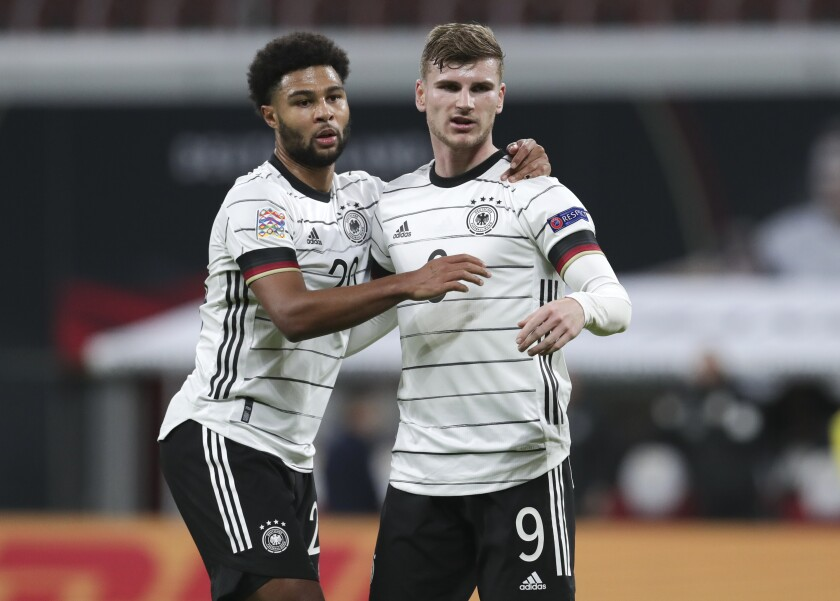 Germany's Timo Werner, right, celebrates with teammate Serge Gnabry after scoring his team's third goal during the UEFA Nations League soccer match between Germany and the Ukraine at the Red Bull Arena in Leipzig, Germany, Saturday, Nov. 14, 2020. (AP Photo/Michael Sohn)