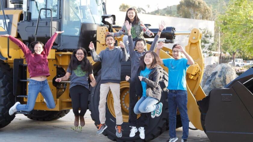 Teens on Tech: (from left) Lucy Gao, 15, Shruti Verma, 14, Pranav Patil, 14, Lily Hu (on tire), 16,