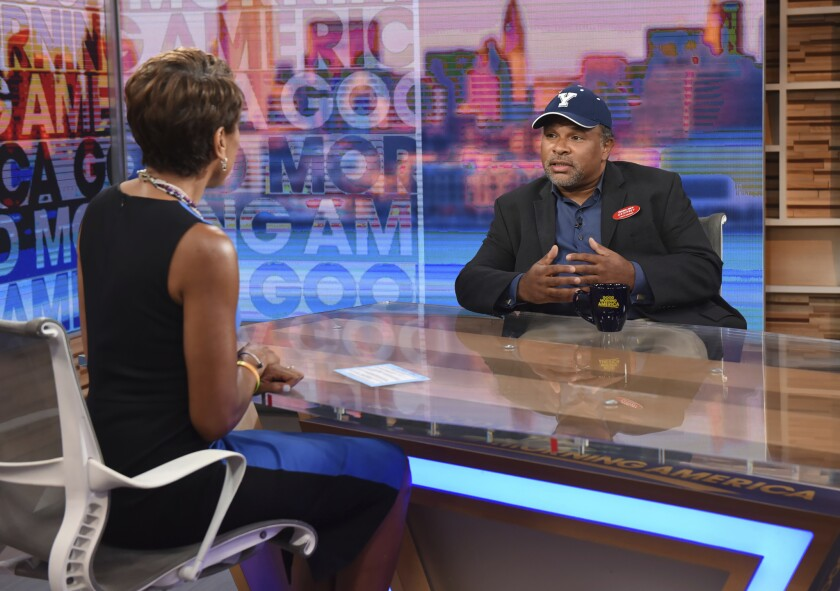 """This image released by ABC shows co-host Robin Roberts, left, with """"The Cosby Show"""" actor Geoffrey O"""