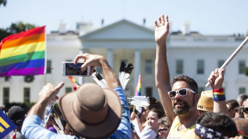 Demonstrators walk past the White House during the Equality March for Unity and Peace on June 11, 2017. Thousands around the country participated in marches for the LGBTQ communities, with the central march taking place in Washington.