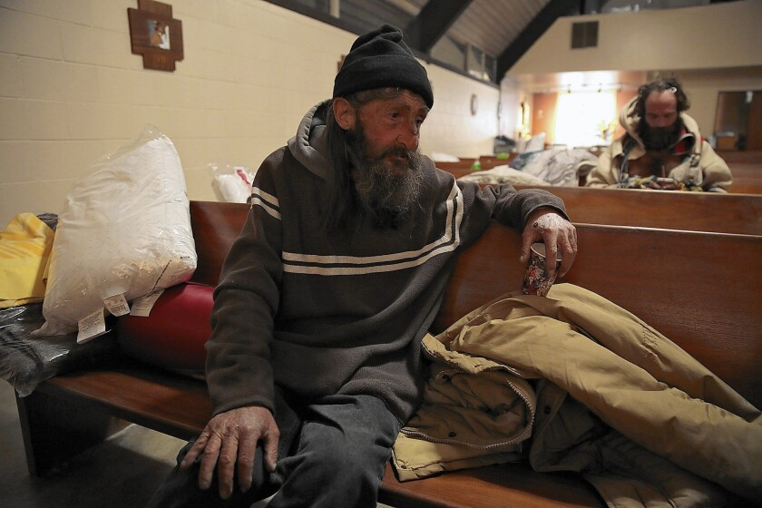 Dale Meyer, 58, settles in for a night at All Saints' Episcopal Church in Highland Park. Meyer said he was born and raised in Highland Park and ended up homeless years ago after he was laid off from a print shop.