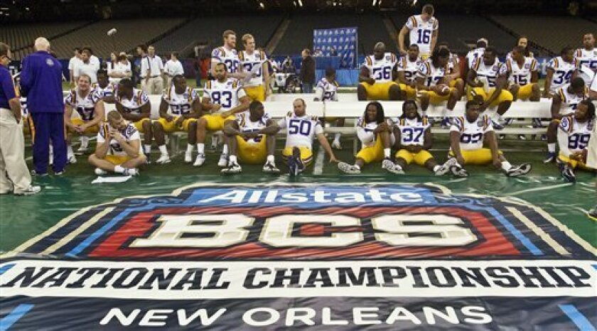 LSU players wait to have their team portrait taken following media day for the BCS championship NCAA college football game at the Superdome in New Orleans, Friday, Jan. 6, 2012. LSU is scheduled to face Alabama for the national championship on Monday, Jan. 9. (AP Photo/Dave Martin)