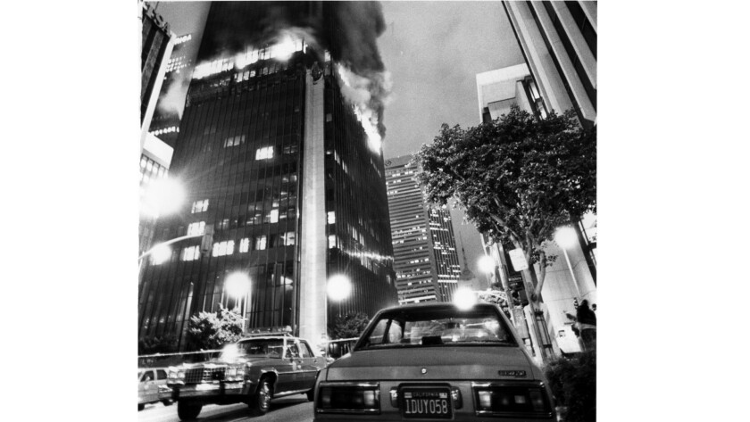 RESCUE PERSONNEL using helicopters plucked five people from the roof of the burning First Interstate Bank Building in downtown Los Angeles in 1988.