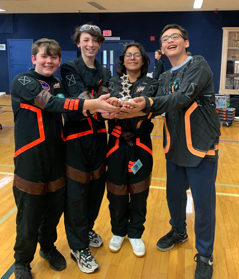 #12605 Dark Voyager team members with their finalist trophy.