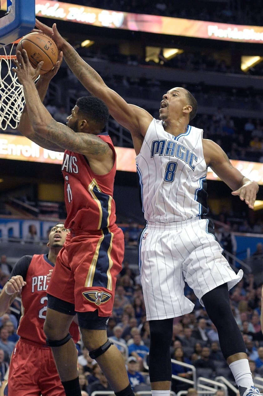 FILE - In this Dec. 28, 2015, file photo, Orlando Magic forward Channing Frye (8) blocks a shot by New Orleans Pelicans forward Alonzo Gee during the first half of an NBA basketball game, in Orlando, Fla. Two people with knowledge of the deal say the Cavaliers have acquired forward Channing Frye fr