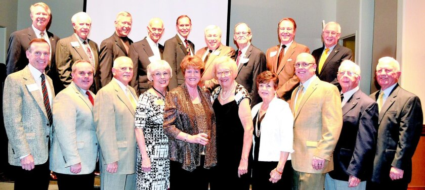 Rotary Club of Rancho Bernardo had 19 of its presidents at the club's 50th anniversary celebration on Dec. 4. They are front row, from left, Gary Saks, Bill Angus, Larry Valente, Ann Calvert, Karen Stelman, Suzie Lisio, Shirley Napierala, Troy Daum, Paul Donick and Don Glover. Back row, Charley Cre