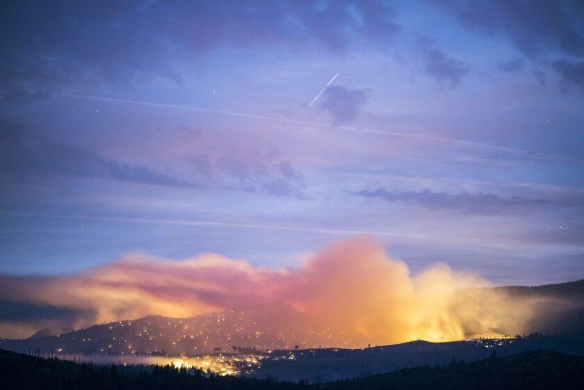 The El Portal fire burns Sunday in Yosemite National Park.