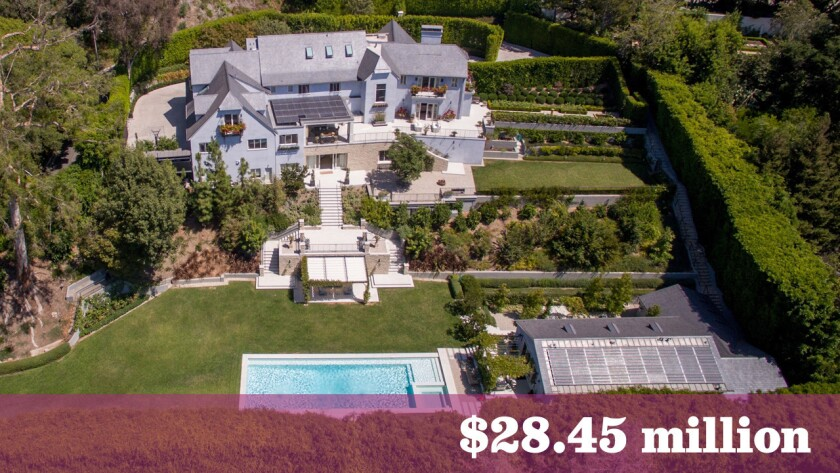 The Beverly Hills estate, home to such Hollywood heavyweights as Freddy DeMann and Gale Anne Hurd, is listed for sale at $28.45 million.