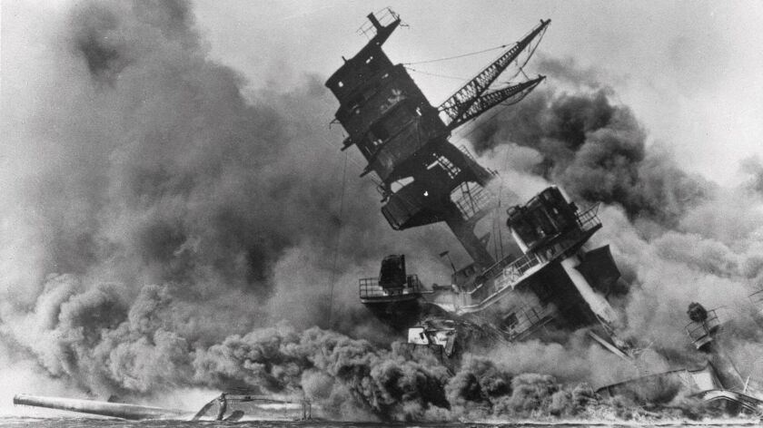 In this Dec. 7, 1941 file photo, smoke rises from the battleship USS Arizona as it sinks during the