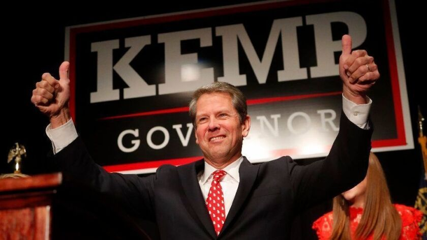 Brian Kemp gives a thumbs-up to supporters at an election-night party in Athens, Ga.