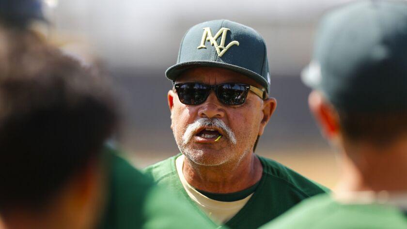 Mar Vista coach Allen Delos Reyes talks with his team before their game against Castle Park.