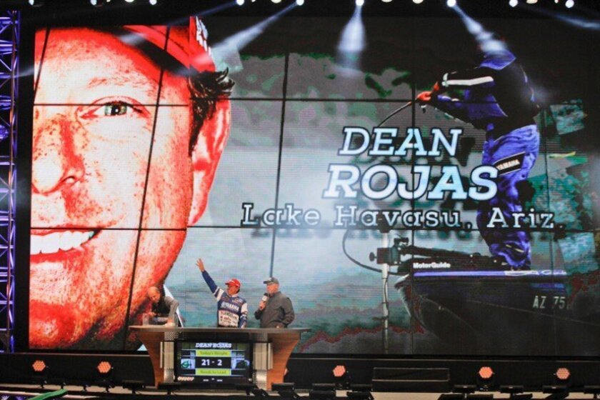 Former San Diegan Dean Rojas took the Day One lead at the 45th Bassmaster Classic by catching five bass totaling 20 pounds, 2 ounces.
