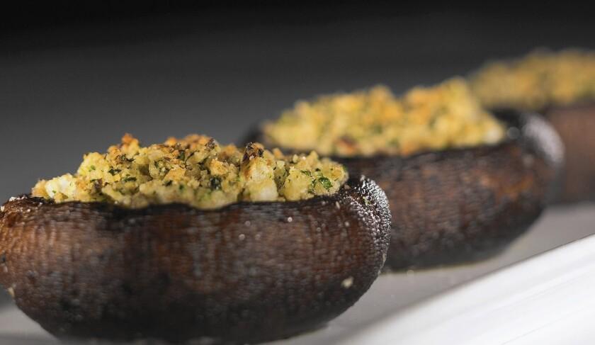 Portobello mushroom caps stuffed with parsley, garlic and matzo