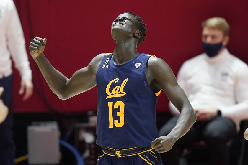 California forward Kuany Kuany reacts as he comes off the court in the second half during the team's NCAA college basketball game against Utah on Saturday, Jan. 16, 2021, in Salt Lake City. (AP Photo/Rick Bowmer)