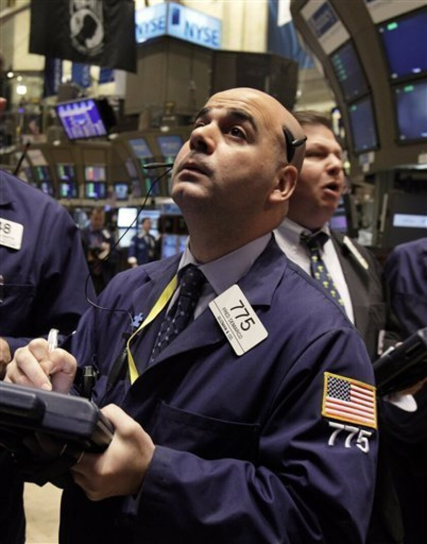 FILE - In this Nov. 3, 2010 file photo, trader Fred Demarco works on the floor of the New York Stock Exchange. (AP Photo/Richard Drew, File)