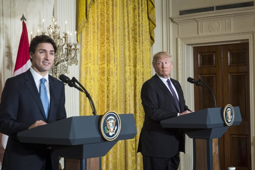President Donald Trump listens to Canadian Prime Minister Justin Trudeau speak at a news conference in the White House on Feb. 13, 2017.