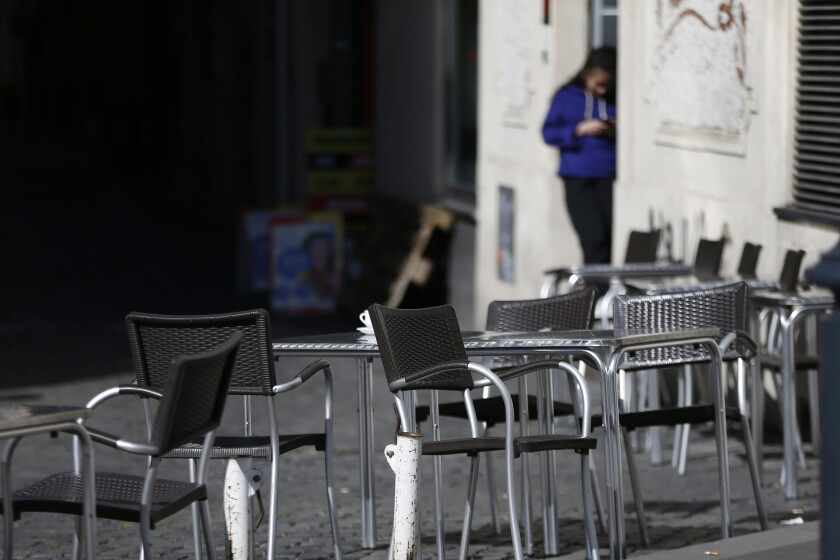 Empty chairs at a Rome cafe