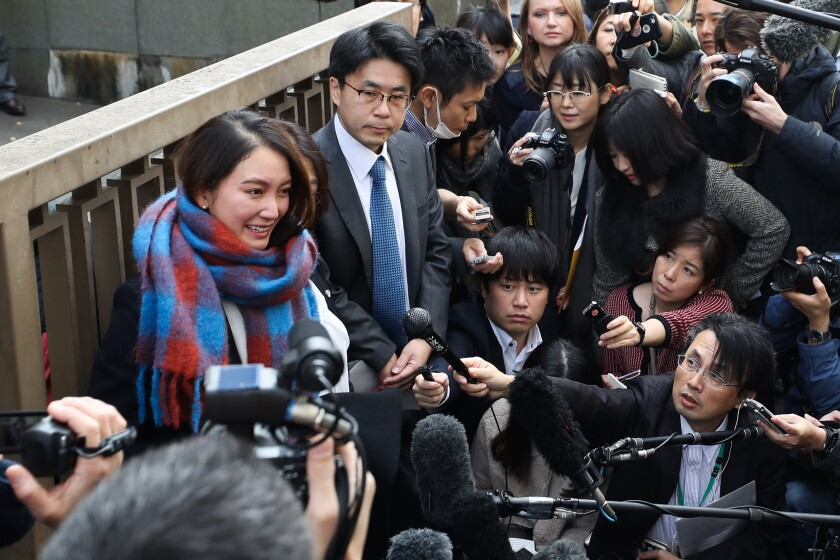 Freelance journalist Shiori Ito fields media questions after Wednesday's ruling in Tokyo. A court ordered former television newsman Noriyuki Yamaguchi to pay $30,150 to Ito for physical and psychological pain resulting from his alleged sexual assault.