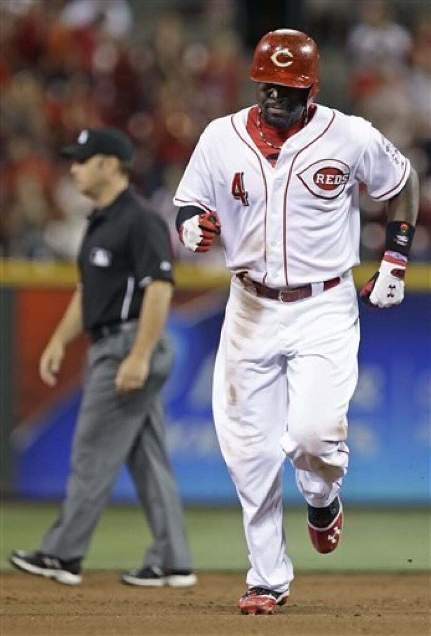 Cincinnati Reds' Brandon Phillips rounds the bases after hitting a solo home run off St. Louis Cardinals starting pitcher Shelby Miller in the fourth inning of a baseball game, Wednesday, Sept. 4, 2013, in Cincinnati. (AP Photo/Al Behrman)