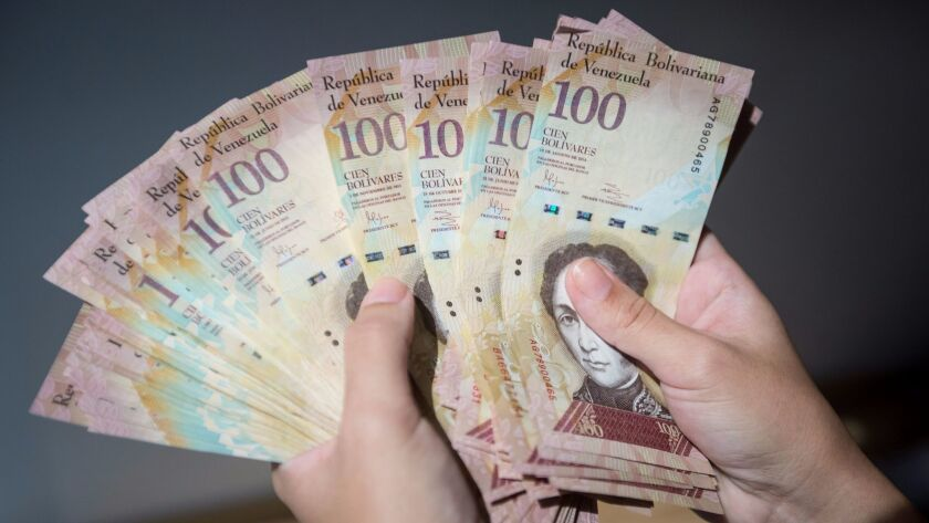 The 100-bolivar bill is Venezuela's largest-denominated bill but worth only about 3 U.S. cents at the widely used black market rate. The nation has decided to pull the bill from circulation.