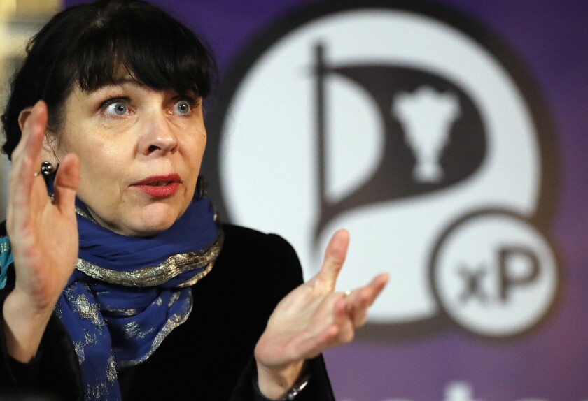 Birgitta Jonsdottir of Iceland's Pirate Party addresses the media during a conference in Reykjavik, Iceland, Sunday, Oct. 30, 2016.