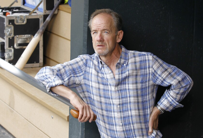 Minnesota Twins owner Jim Pohlad looks out from the dugout.