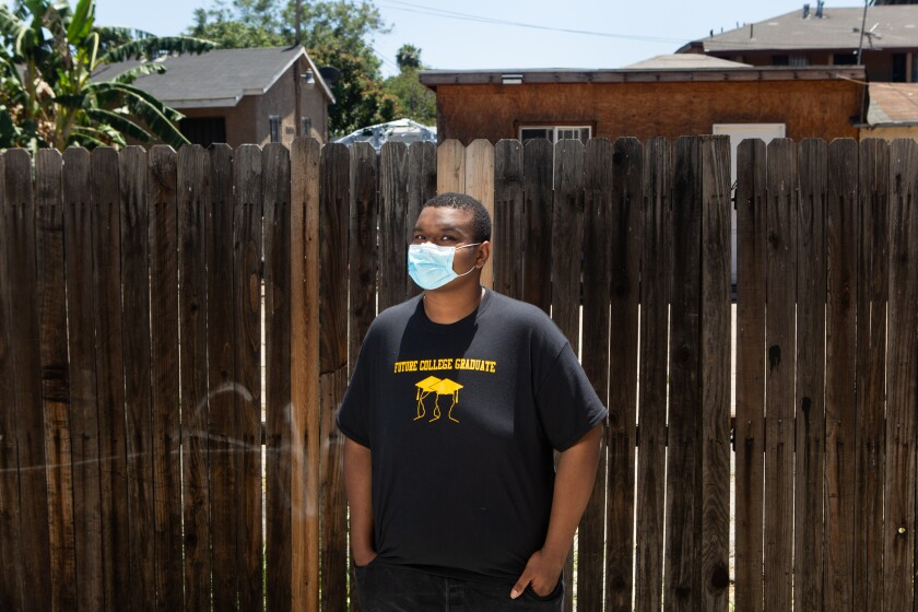 Keith Wallick, 17, poses for a portrait in his South L.A. neighborhood.