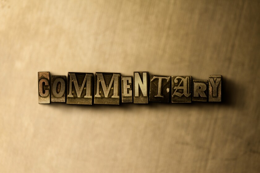 COMMENTARY - close-up of grungy vintage typeset word on metal backdrop