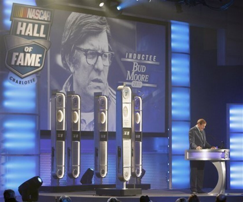 Bud Moore speaks after being inducted into the NASCAR Hall of Fame during a ceremony in Charlotte, N.C., Monday, May 23, 2011. (AP Photo/Chuck Burton)