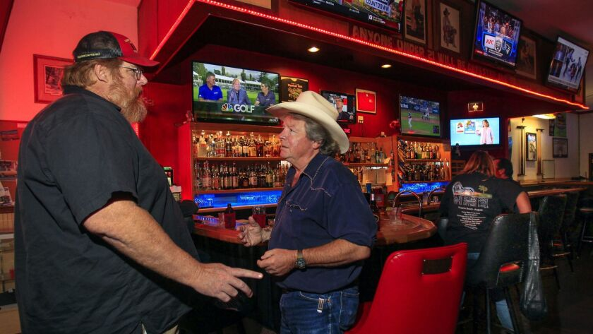 Pete Beauregard, center, who ran as a Democrat in the 50th Congressional District, talks to Larry Miller at the Turkey Inn.
